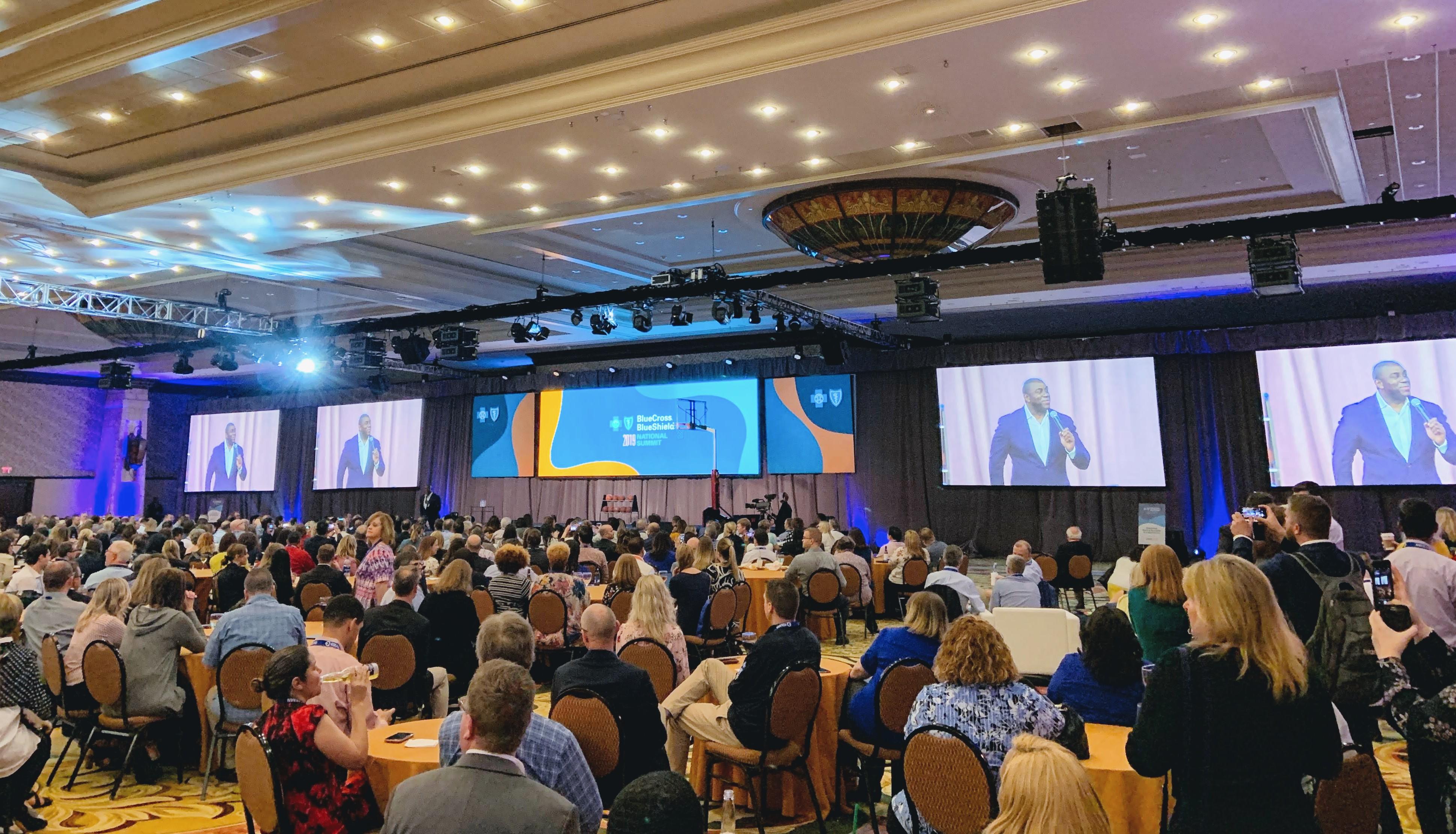 Magic Johnson speaks at the Blue Cross Blue Shield National Summit 2019 in Dallas, Texas.